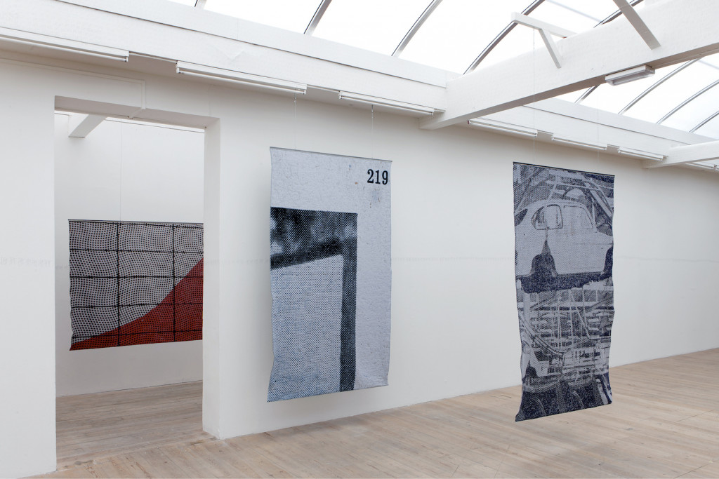 """Kristina Benjocki, """"Study of Focus,"""" 2014. Ten woven tapestries, 165 × 247.5 cm each, wool and metal. Installation view of """"This is the Time. This is the Record of the Time"""" at SMBA, Sep 13–Nov 9, 2014. Photo: Gert Jan van Rooij. Courtesy the artist."""
