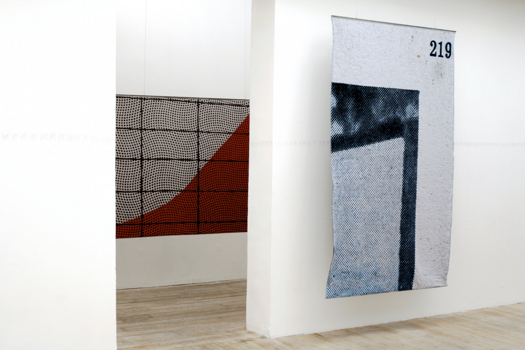 """Kristina Benjocki, """"Study of Focus,"""" 2014. Ten woven tapestries, 165 × 247.5 cm each, wool and metal. Installation view of """"This is the Time. This is the Record of the Time"""" at SMBA, Sep 13–Nov 9, 2014. Photo: Kristina Benjocki. Courtesy the artist."""