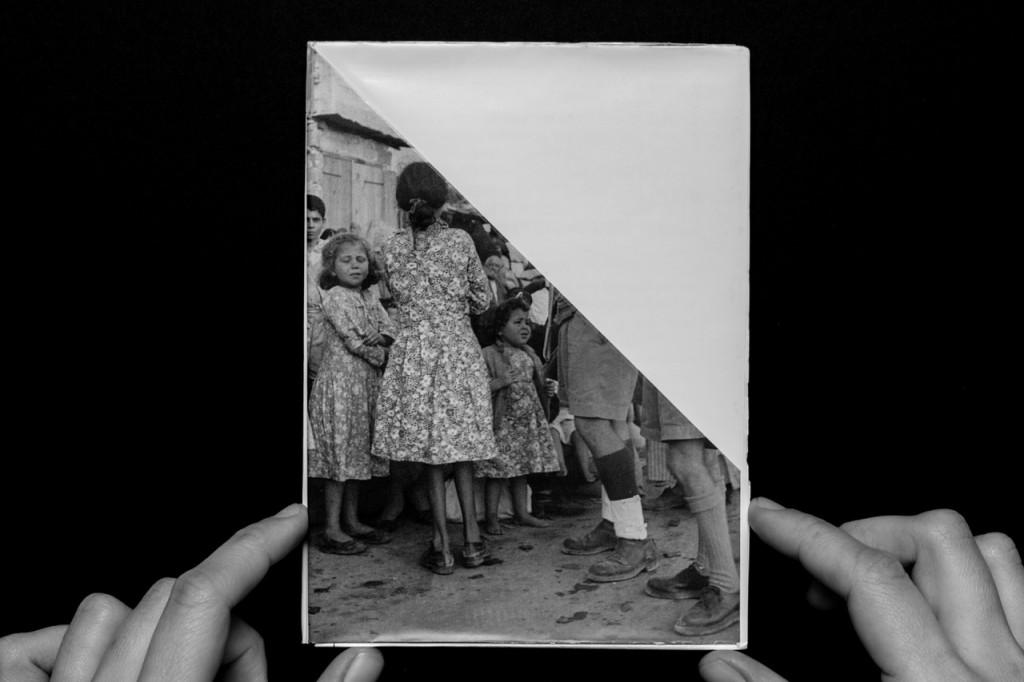 "Folded photograph of the expulsion of Palestinians from Ramle, 1948. From Ariella Aïsha Azoulay's exhibition ""Potential History,"" 2012, various locations. Photo: Michael Paninski. Courtesy Ariella Aïsha Azoulay."