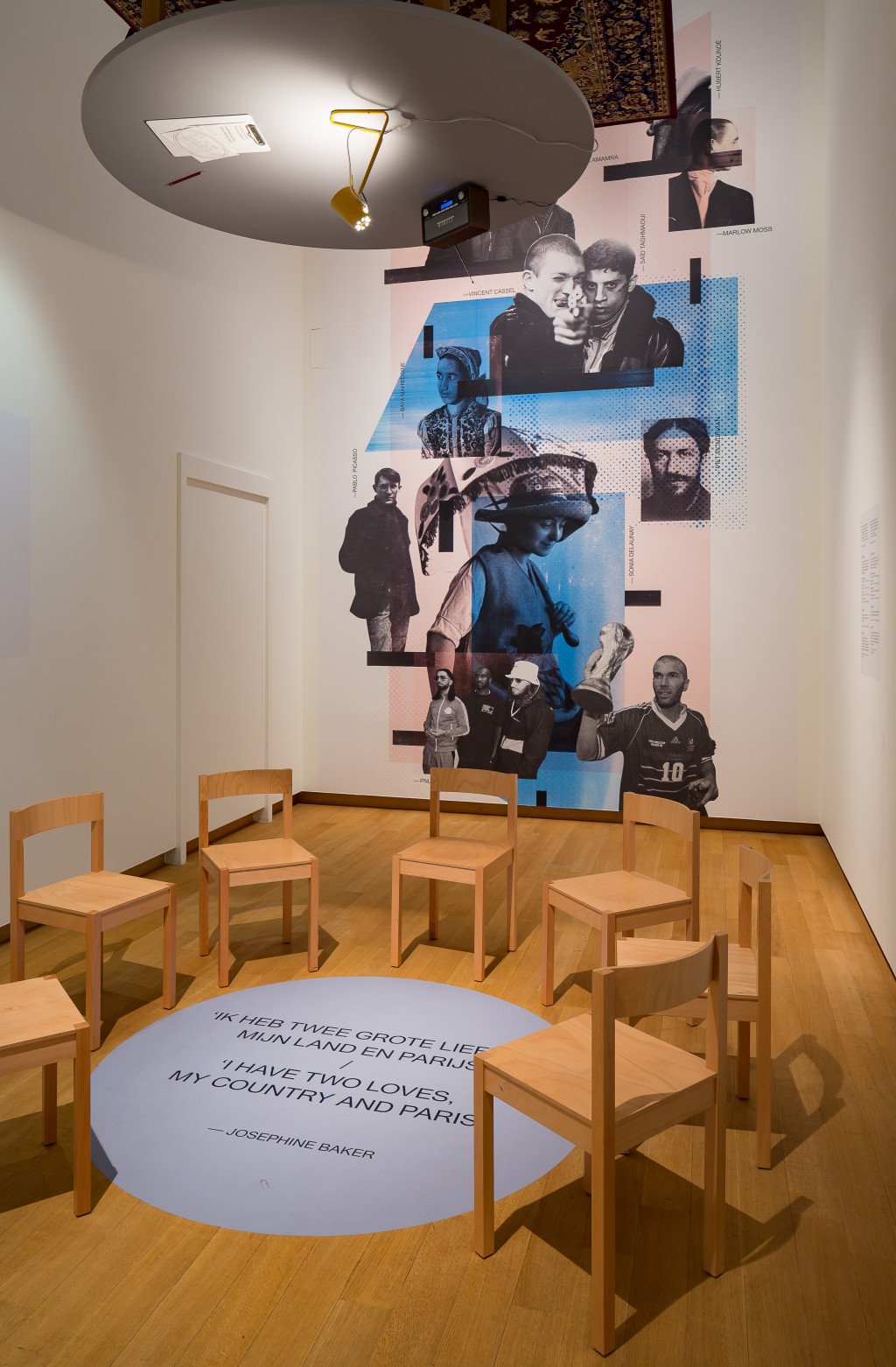 The Salon, wall collage with immigrants in Paris, then and now, including the artists Chagall, Sonia Delaunay, Marlow Moss, Baya Mahieddine, singer Aya Nakamura and rap duo PNL. Their music could also be heard in The Salon. Photo: Peter Tijhuis.