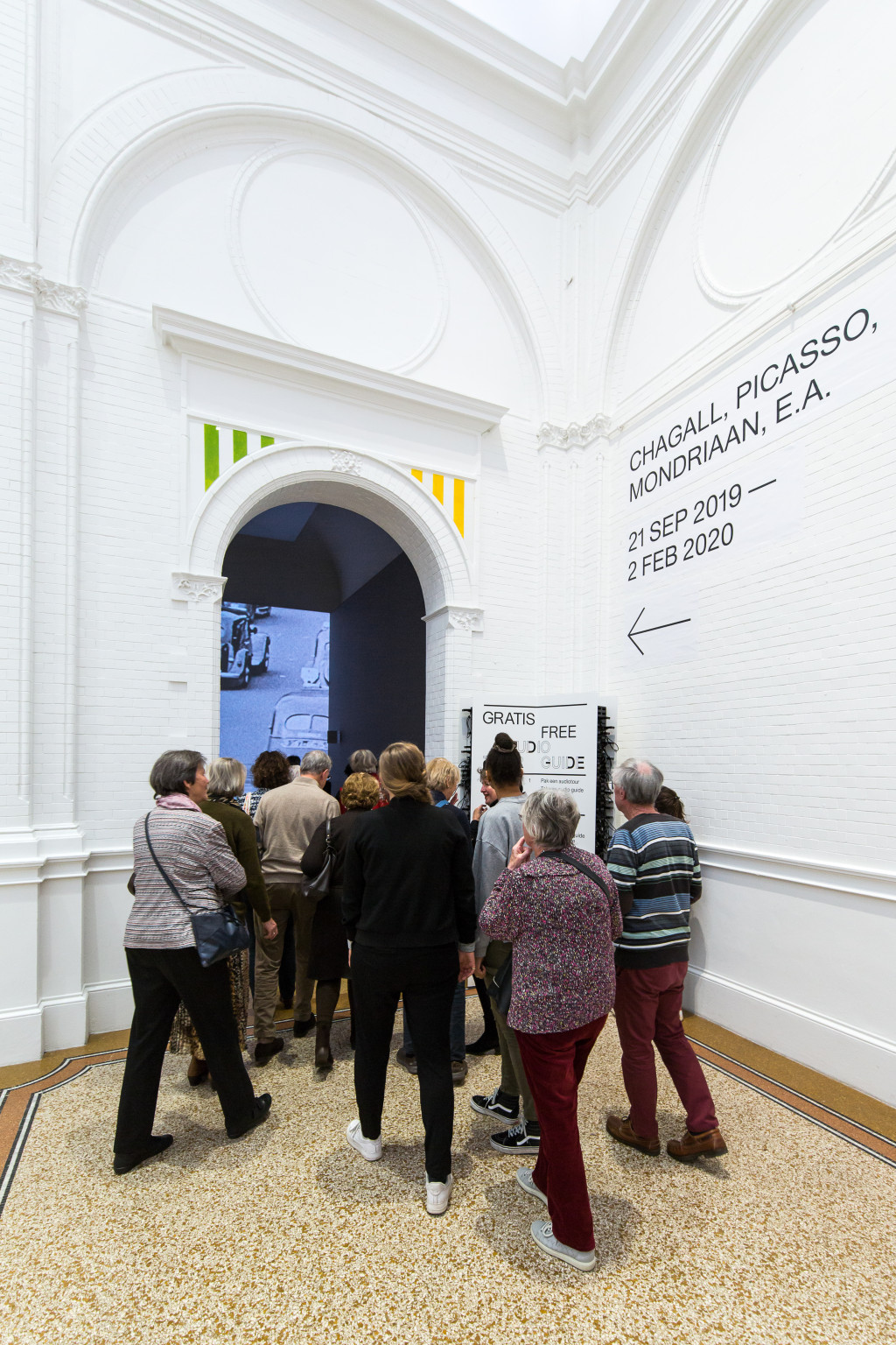 Visitors at the entrance to the exhibition. Photo: Maarten Nauw.