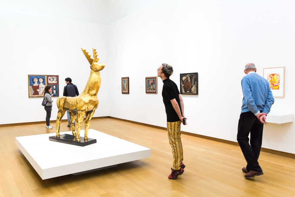 Visitors at the opening. From left to right, works by: Campigli; Zadkine; Severini (2 x);  Rivera, all gifts of P.A. Regnault to the Dutch State, on loan to the Stedelijk Museum, 1953; and Goncharova. Photo: Maarten Nauw.