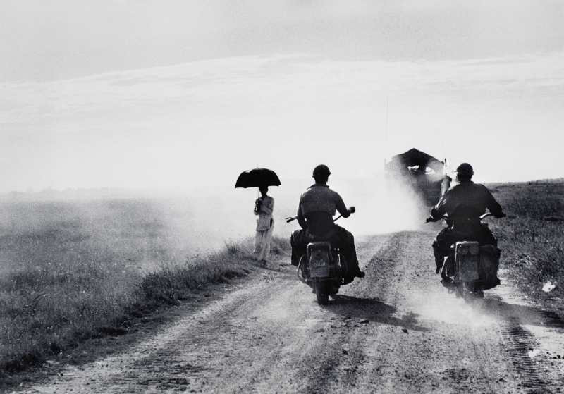 Robert Capa, On the Road from Namdinh to Thaibinh, Indochina (Vietnam), May 25, 1954.