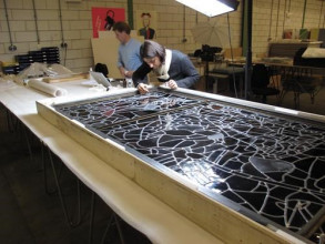 Lisya Bicaci is consolidating cracks in a stained-glass window by Joep Nicolas