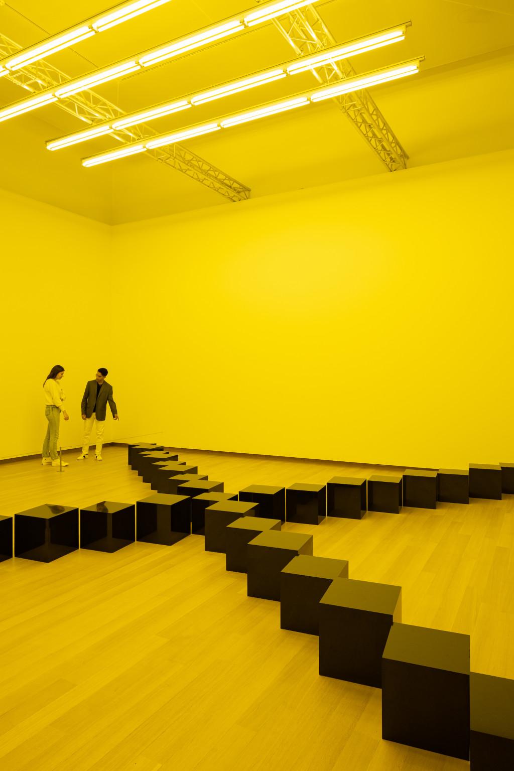 "Installation view. Bruce Nauman, Black Marble Under Yellow Light, 1987, coll. Fundacion ""la Caixa"", Barcelona. Photo: Peter Tijhuis © 2021 Bruce Nauman / Pictoright Amsterdam"