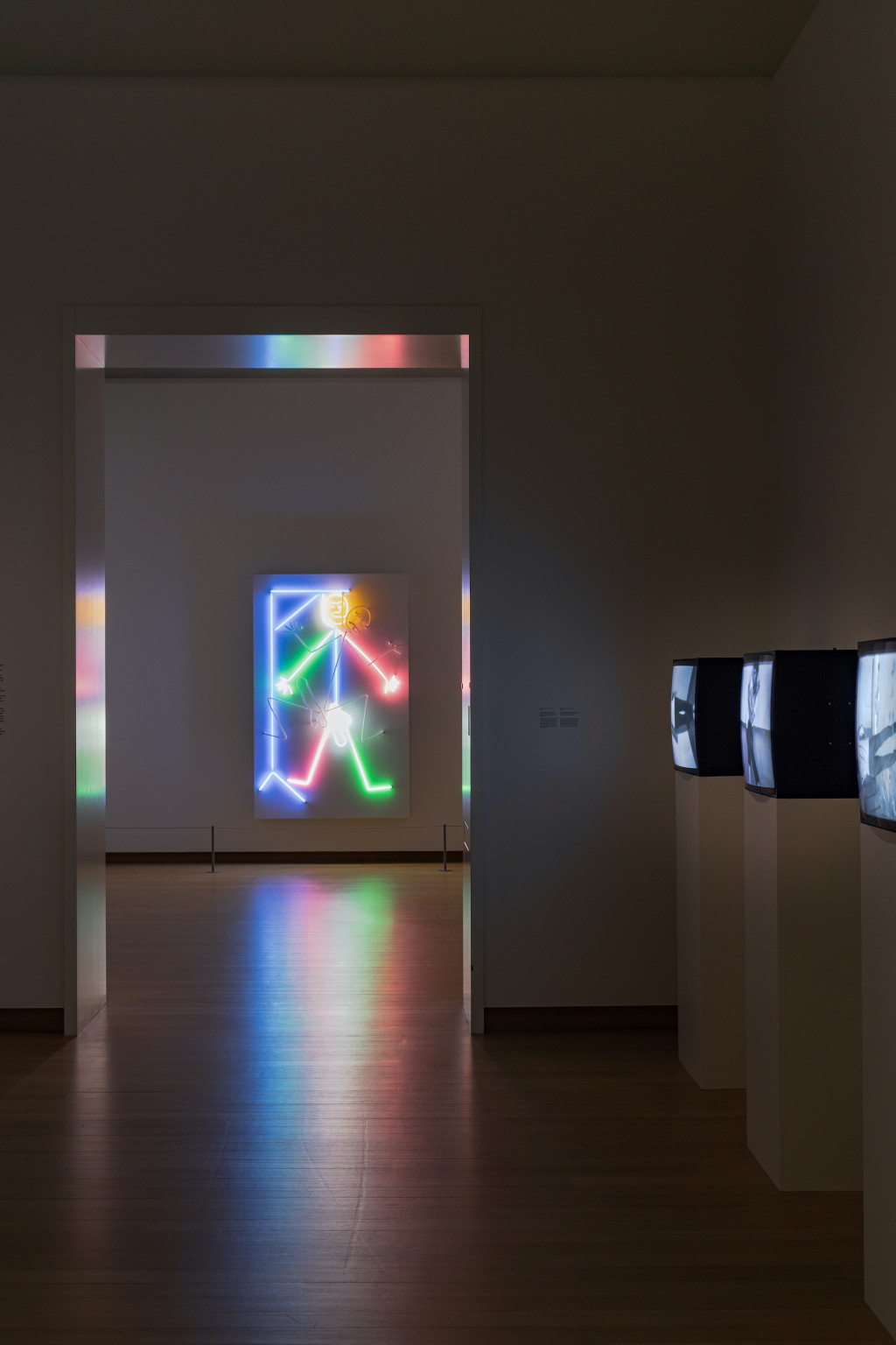 Installation view. Left: Hanged Man, 1985; right: Bouncing in the Corner, No.1 (1968), Violin tuned D E A D (1969), Wall-Floor Positions (1968), Electronic Arts Intermix, (EAI), New York, NY. Photo: Peter Tijhuis © 2021 Bruce Nauman