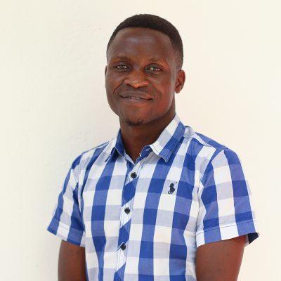 Portrait shot, man in flannel shirt, blue, white