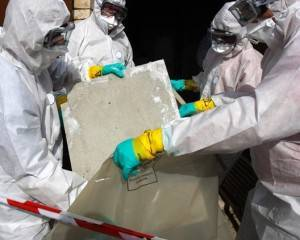 Asbestos Awareness training nationwide from project skills solutions, men in protection moving asbestos