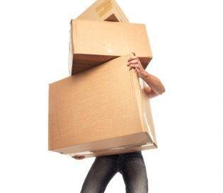 Man struggling with boxes - Manual Handling Training