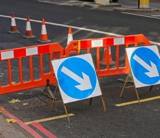 Streetworks and temporary traffic signs on road. Liverpool streetworks and training centre.