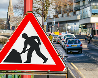 Road works sign on UK highways, traffic, red sign - NRSWA Courses
