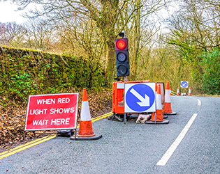 Streetworks signs on country road, roadworks and NRSWA courses in Nottingham.