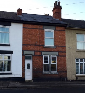 A two bedroomed mid-terraced property requiring a full scheme of modernisation and improvements.