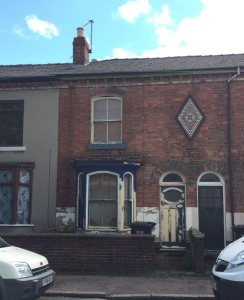 A two bedroomed palisaded mid-terraced property which requires a scheme of modernisation and improvement.
