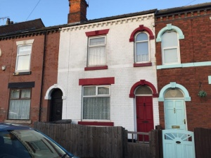 A traditional two bedroomed mid-terraced property with passaged entrance hall with partial double glazing but otherwise a scheme of upgrading and improvement