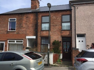 A traditional three bedroomed mid-terraced property requiring a scheme of modernisation and improvement for which there is ample scope.