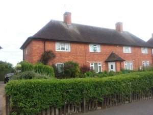 Traditional three bedroomed end of terraced property with part double glazing and having open fields to rear.