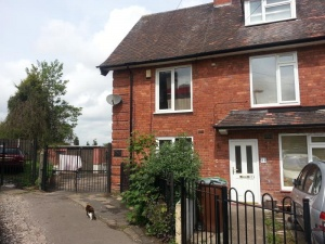 Two bedroomed end terrace house with additional attic room, in need of upgrading and improvement