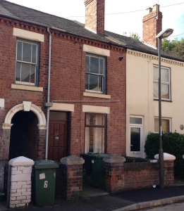 A three bedroomed mid terraced property requiring modernisation and improvements.