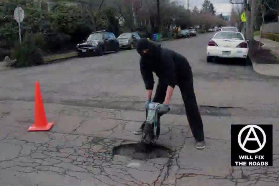 Anarchist group repairing Portland potholes