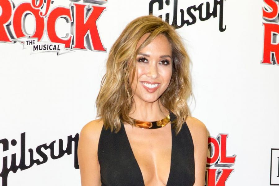 Myleene is all front in plunging jumpsuit at School of Rock