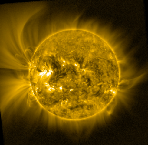 A picture of the Sun, appearing yellow, with its corona visible against a black background.