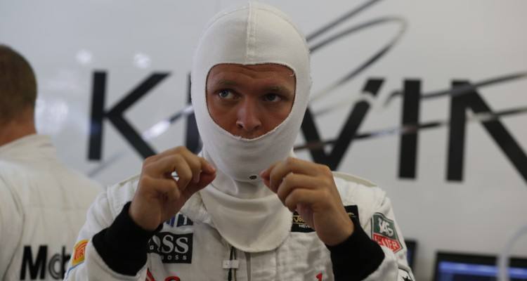 Kevin Magnussen prepares in the garage.