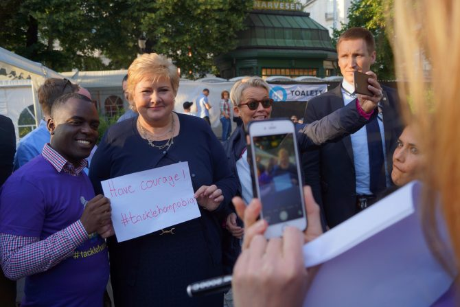 Norwegian Prime Minister Erna Solberg and SMUG Director Frank Mugisha met at the Oslo Pride in June 2016, where she joined the campaign against homophobia in football, #tacklehomophobia.