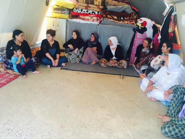 Yanar Mohammed visiting Yazidi women in a refugee camp near the city of Dohuk in Kurdistan, September 2015