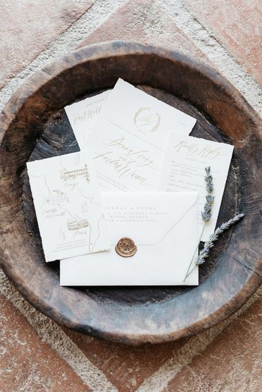 "Stationery by <a href=""https://writtenwordcalligraphy.com/destination-tuscan-wedding-invitations/"" target=""_blank"">Written Word</a>"