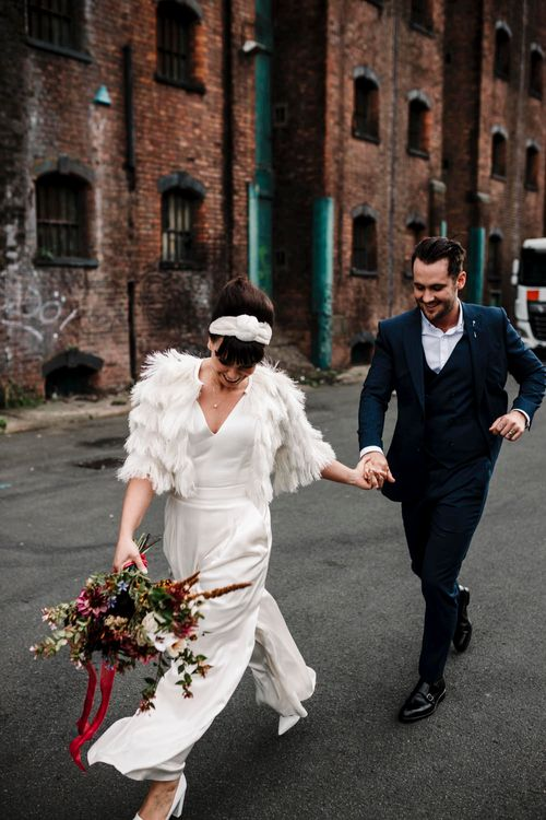 Bride and groom dancing in the streets in Liverpool