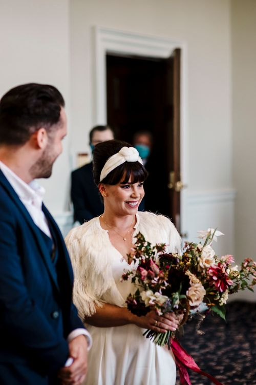 Bride with fringe and headband at micro wedding