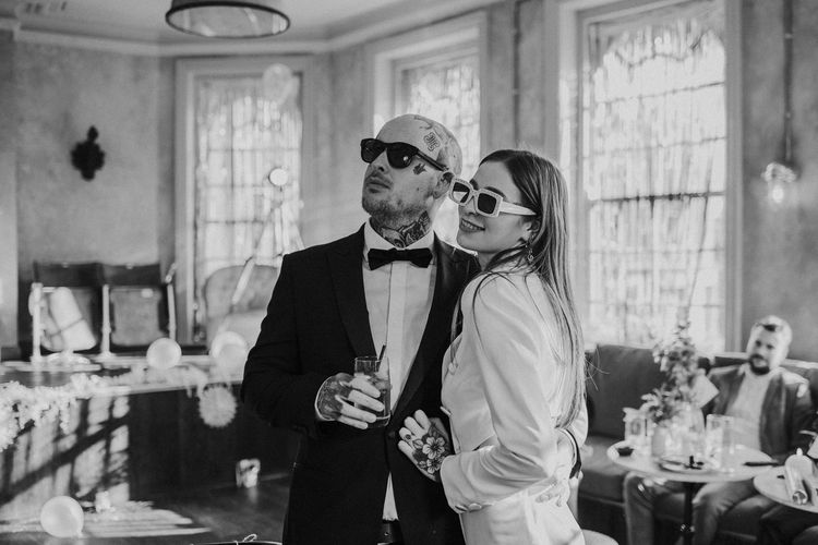 Stylish bride and groom in sunglasses at Brighton micro wedding