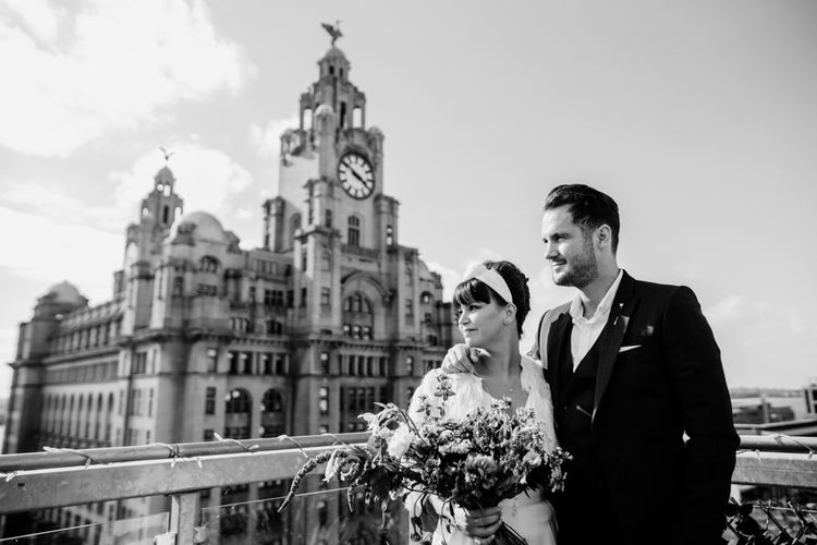 Bride and groom at rooftop bar for Liverpool wedding