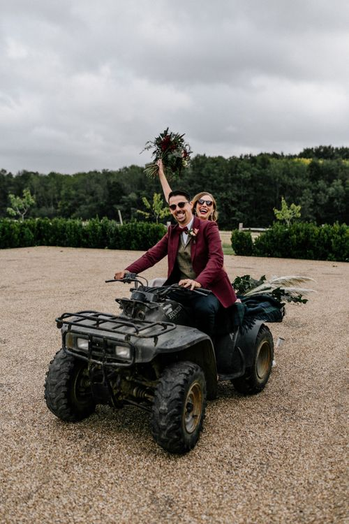 wedding portrait by Epic Love Story of a bride and groom riding a quad bike