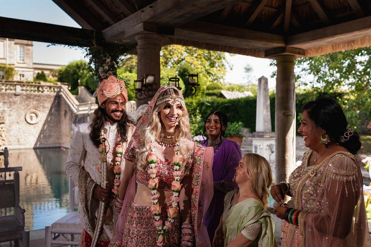 Bride in pink pink Indian wedding dress at The Lost Orangey Hindu ceremony