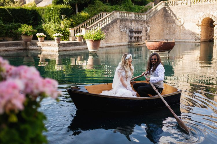 Bride and groom on the boat at The Lost Orangery