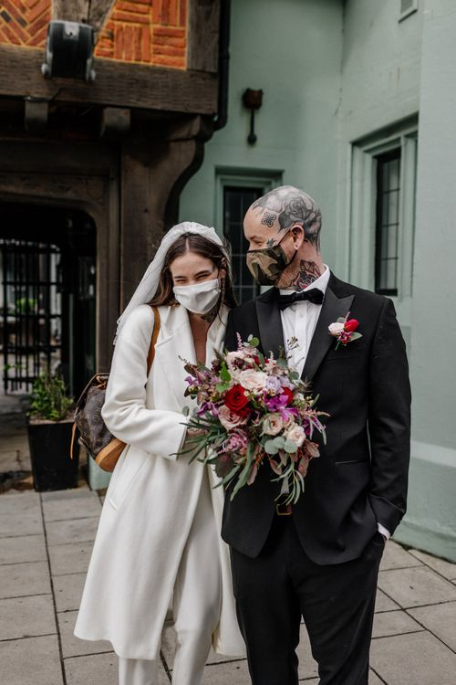 Bride and groom in face masks at 2020 wedding