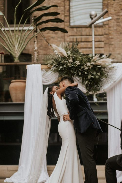 First kiss and husband and wife at Devonshire Terrace wedding