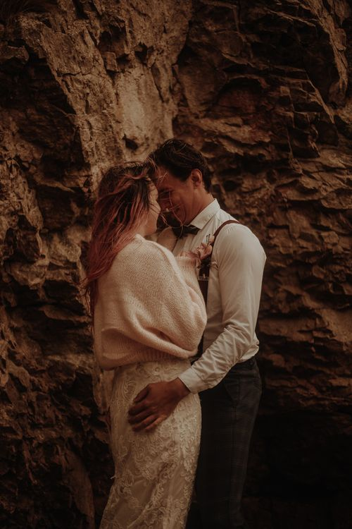 Bride in wooden cardigan at intimate elopement