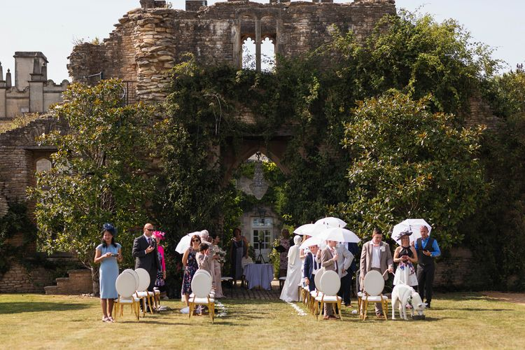 Outdoor wedding ceremony at the ruins in Euridge Manor