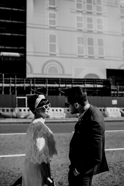 Stylish bride and groom in sunglasses