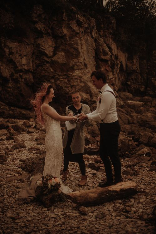 Windy elopement with hand fastening ceremony