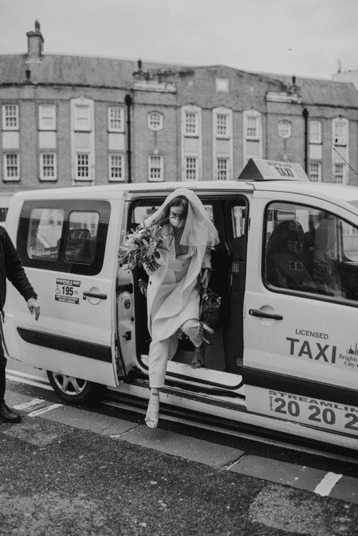 Bride arriving at wedidng in black cab