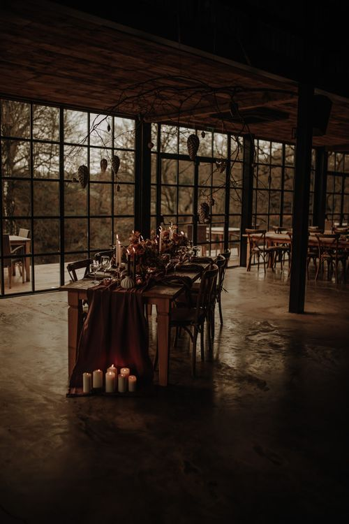 Winter wedding styling with candles and hanging bauble installation