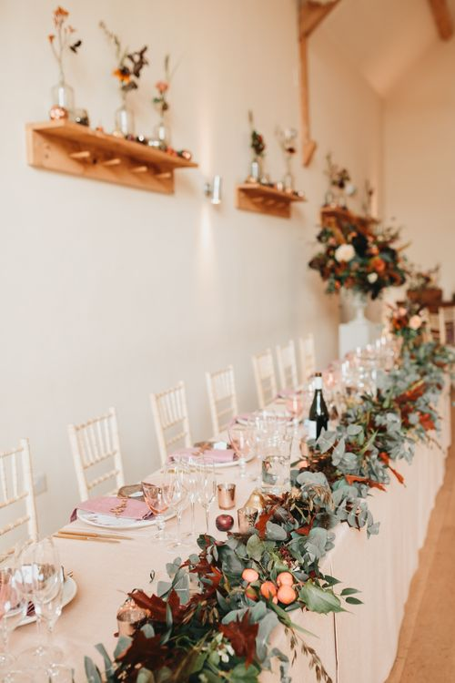 Millbridge Court top table wedding flowers with foliage and apples