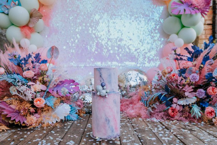 Pastel marble effect wedding cake with sequin backdrop