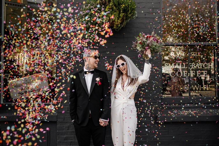 Colourful confetti moment for alternative couple at pub wedding reception