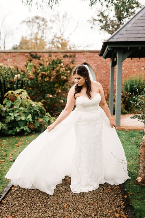 Bride in white wedding dress with double skirt