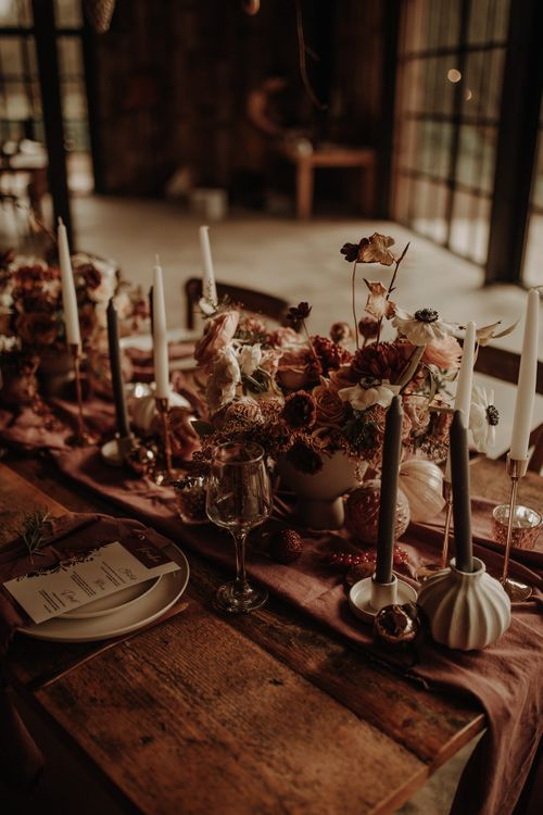 autumn wedding table decor with table runner, flowers and taper candles